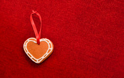 Gingerbread cookie heart and decorative ribbon Stock Photos