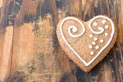 Gingerbread Cookie Heart on a Rustic Wooden Background Stock Images