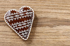 Gingerbread cookie in heart shape on a wooden background Stock Photography