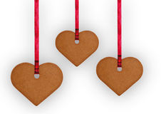 Gingerbread cookie hearts. Three gingerbread cookie hearts ón white background Royalty Free Stock Image