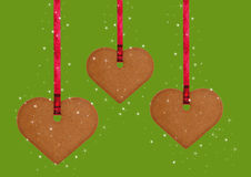 Gingerbread cookie hearts. Three gingerbread cookie hearts and stars Stock Photo