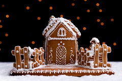 Gingerbread cookie house on dark background Royalty Free Stock Image