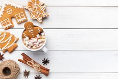 Gingerbread cookie man in cup of hot chocolate. Sweet Christmas composition. Gingerbread cookie man in cup of hot chocolate on white background with copy space stock image