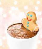 Gingerbread cookie man take a bath in cup of Hot Chocolate, over Stock Photo