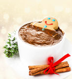 Gingerbread cookie man take a bath in cup of Hot Chocolate, over Stock Image
