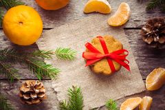 Gingerbread Cookie with mandarins on Christmas background Stock Image