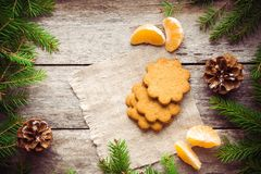 Gingerbread Cookie with mandarins on Christmas background Stock Photo