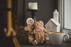 Gingerbread cookie men in a hot cup of cappuccino Royalty Free Stock Image