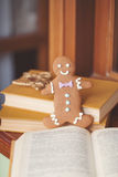 Gingerbread cookie men in a hot cup of cappuccino Royalty Free Stock Images