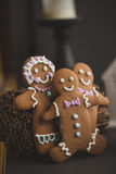 Gingerbread cookie men in a hot cup of cappuccino Stock Photos