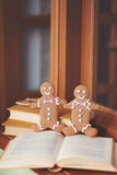 Gingerbread cookie men in a hot cup of cappuccino Stock Images