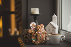 Gingerbread cookie men in a hot cup of cappuccino Stock Photo