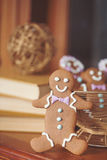 Gingerbread cookie men in a hot cup of cappuccino Stock Image