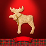 Gingerbread cookie on red  background Royalty Free Stock Photography
