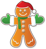 Gingerbread cookie in santa claus hat Royalty Free Stock Photos