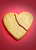 Gingerbread cookie in the shape of a broken heart Stock Images