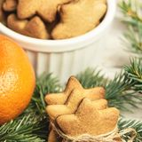Gingerbread Cookie. Small stars. Delicious tangerine. NewYear. F. Ir branch stock photo