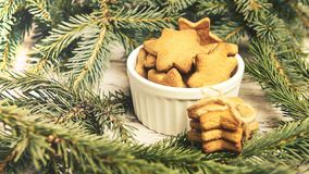 Gingerbread Cookie. Small stars. NewYear. Fir branch.  royalty free stock photography