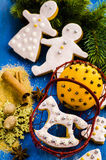 Gingerbread cookies. On a background of spices and Christmas trees Royalty Free Stock Image