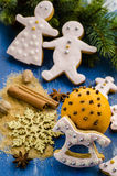 Gingerbread cookies. On a background of spices and Christmas trees Stock Image