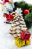 Gingerbread cookies. On a background of spices and Christmas trees Royalty Free Stock Photography