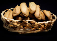 Gingerbread cookies in a basket on a black background. Homemade baking Stock Photography