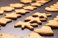 Gingerbread cookies bear in dance with hearts and stars Stock Photos