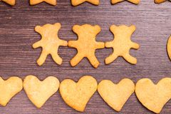 Gingerbread cookies bear in dance with hearts Stock Image