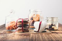 Free Gingerbread Cookies, Candies, Cakes, Sweets In Jars On Wooden Table Royalty Free Stock Photography - 139173297