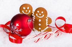 Gingerbread cookies and candy canes with Christmas ball Stock Image