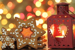 Gingerbread cookies. Christmas gingerbread cookies on a blurred background of lights stock photography