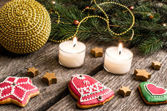 Gingerbread cookies and Christmas decoration over wooden table Stock Photo
