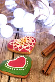 Gingerbread cookies and Christmas decoration over wooden table Stock Image
