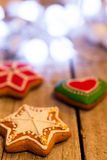 Gingerbread cookies and Christmas decoration over wooden table Stock Photography