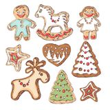 Gingerbread cookies for Christmas. Little people and fir-trees, a deer and a horse. Royalty Free Stock Photos