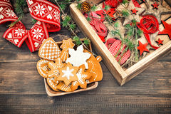Gingerbread cookies and Christmas ornaments. Retro style home de Stock Photo