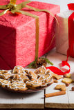Gingerbread cookies for Christmas with red present Stock Images