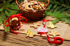 Gingerbread cookies for Christmas scrolled red ribbon. On old wooden table Stock Photography