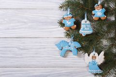 Gingerbread cookies on Christmas tree. Stock Image