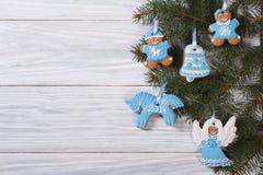 Gingerbread cookies on Christmas tree. Stock Image