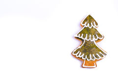 Gingerbread cookies christmas tree. Gingerbread cookies and spices over white background close up christmas decoration Stock Photo