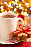 Gingerbread cookies and a cup of tea Stock Image