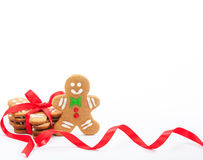 Gingerbread Cookies. Cute Christmas gingerbread cookies tied with red ribbon on white royalty free stock image