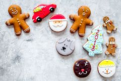 Gingerbread cookies of different shapes on stone background top view copyspace Royalty Free Stock Photos