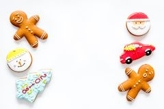 Gingerbread cookies of different shapes on white background top view copyspace Royalty Free Stock Images