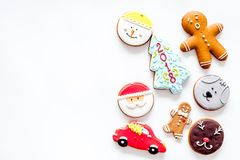 Gingerbread cookies of different shapes on white background top view copyspace Royalty Free Stock Photo