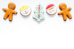 Gingerbread cookies of different shapes on white background top view space for text Royalty Free Stock Photography