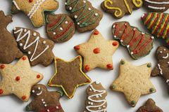 Gingerbread cookies in festive shapes with colorful frosting decoration stock photo