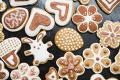Gingerbread cookies in the form of a rabbit, flowers, hearts, grandmothers and Easter eggs, covered with white and chocolate icing stock photo