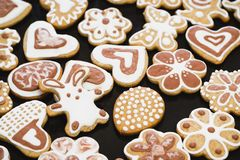 Gingerbread cookies in the form of a rabbit, flowers, hearts, grandmothers and Easter eggs, covered with white and chocolate icing royalty free stock images